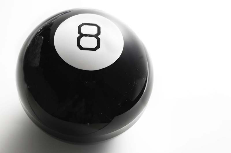 closeup of a billiard 8 ball, on white