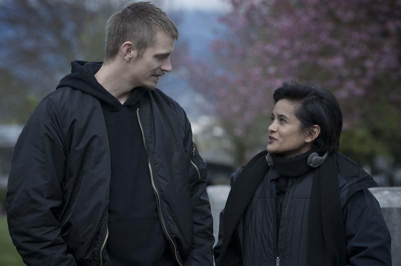 Joel Kinnaman talks on set with The Killing creator and executive producer Veena Sud. Carole Segal for Netflix.