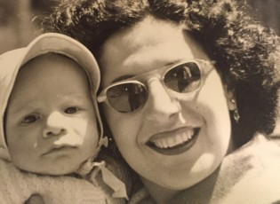 Roy Peter Clark, age 5-months, with his mother Shirley Hope Clark.  If you look closely, you can see Clark's father Ted reflected in her sunglasses.