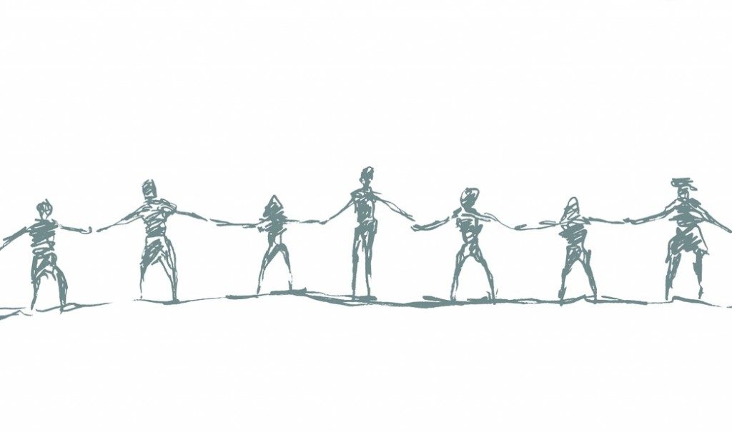 Networking for introverts: A group of people come together and hold hands.